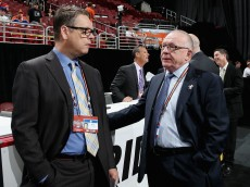 PHILADELPHIA, PA - JUNE 28: Tim Murray, General Manager of the Buffalo Sabres speaks with Jim Rutherford, General Manager of the Pittsburg Penguins on Day Two of the 2014 NHL Draft at the Wells Fargo Center on June 28, 2014 in Philadelphia, Pennsylvania.  (Photo by Bruce Bennett/Getty Images)