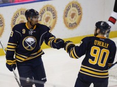 BUFFALO, NY - SEPTEMBER 23: Evander Kane #9, left, celebrates with teammate Ryan O'Reilly #90 of the Buffalo Sabres after scoring a goal during a game against the Ottawa Senators at the First Niagara Center on September 23, 2015 in Buffalo, New York. (Photo by Tom Brenner/ Getty Images)