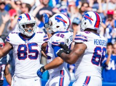ORCHARD PARK, NY - SEPTEMBER 20:  Jerome Felton #42 and Seantrel Henderson #66 congratulate Charles Clay #85 of the Buffalo Bills on a second quarter touchdown reception against the New England Patriots on September 20, 2015 at Ralph Wilson Stadium in Orchard Park, New York.  (Photo by Brett Carlsen/Getty Images)