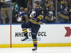 Oct 8, 2015; Buffalo, NY, USA; Buffalo Sabres center Jack Eichel (15) celebrates after scoring his first NHL goal during the third period against the Ottawa Senators at First Niagara Center. Mandatory Credit: Kevin Hoffman-USA TODAY Sports