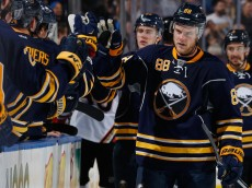 BUFFALO, NY - DECEMBER 17: Jamie McGinn #88 of the Buffalo Sabres celebrates his goal against the Anaheim Ducks with teammates along the bench at First Niagara Center on December 17, 2015 in Buffalo, New York. Buffalo defeated Anaheim 3-0.  (Photo by Jen Fuller/Getty Images)