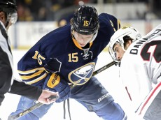 BUFFALO, NY - DECEMBER 19: Jack Eichel #15 of the Buffalo Sabres takes a face off against Phillip Danault #24 of the Chicago Blackhawks at the First Niagara Center on December 19, 2015 in Buffalo, New York. (Photo by Tom Brenner/ Getty Images)