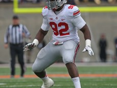 CHAMPAIGN, IL - NOVEMBER 16:  Adolphus Washington #92 of the Ohio State Buckeyes rushes against the Illinois Fighting Illini at Memorial Stadium on November 16, 2013 in Champaign, Illinois. Ohio State defeated Illinois 60-35.  (Photo by Jonathan Daniel/Getty Images)