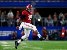 ARLINGTON, TX - DECEMBER 31:  Linebacker Reggie Ragland #19 of the Alabama Crimson Tide reacts after stopping the Michigan State Spartans on third down in the first quarter during the Goodyear Cotton Bowl at AT&T Stadium on December 31, 2015 in Arlington, Texas.  (Photo by Tom Pennington/Getty Images)