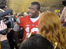 Jan 12, 2015; Arlington, TX, USA; Ohio State Buckeyes quarterback Cardale Jones (12) is interviewed after the win over Oregon Ducks in the 2015 CFP National Championship Game at AT&T Stadium. Ohio State won 42-20. Mandatory Credit: Kirby Lee-USA TODAY Sports