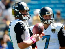 JACKSONVILLE, FL - OCTOBER 05:   Blake Bortles #5 and Chad Henne #7 of the Jacksonville Jaguars warm up before the game against the Pittsburgh Steelers during the game at EverBank Field on October 5, 2014 in Jacksonville, Florida.  (Photo by Sam Greenwood/Getty Images)