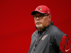 GLENDALE, AZ - AUGUST 02:  Head coach Bruce Arians of the Arizona Cardinals stands on the field during the team training camp at University of Phoenix Stadium on August 2, 2015 in Glendale, Arizona.  (Photo by Christian Petersen/Getty Images)