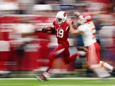 GLENDALE, AZ - DECEMBER 07: Wide receiver Ted Ginn #19 of the Arizona Cardinals runs back a kickoff during the first half of the NFL game against the Kansas City Chiefs at the University of Phoenix Stadium on December 7, 2014 in Glendale, Arizona.  (Photo by Christian Petersen/Getty Images)