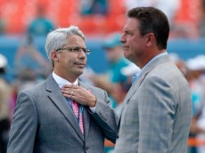 MIAMI GARDENS, FL - OCTOBER 12:  Miami Dolphins General Manager Dennis Hickey (L) speaks with former Dolphins quarterback Dan Marino before the Dolphins met the Green Bay Packers during a game at Sun Life Stadium on October 12, 2014 in Miami Gardens, Florida.  (Photo by Joel Auerbach/Getty Images)