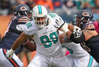 CHICAGO, IL - OCTOBER 19: Jared Odrick #98 of the Miami Dolphins rushes past  Matt Slauson #68 of the Chicago Bears at Soldier Field on October 19, 2014 in Chicago, Illinois. The Dolphins defeated the Bears 27-14. (Photo by Jonathan Daniel/Getty Images)