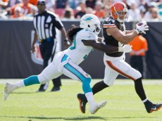 CLEVELAND, OH - SEPTEMBER 8: Inside linebacker Dannell Ellerbe #59 of the Miami Dolphins tackles tight end Jordan Cameron #84 of the Cleveland Browns during the second half at First Energy Stadium on September 8, 2013 in Cleveland, Ohio. The Dolphins defeated the Browns 23-10. (Photo by Jason Miller/Getty Images)