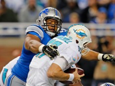DETROIT, MI - NOVEMBER 09: Ndamukong Suh #90 of the Detroit Lions sacks Ryan Tannehill #17 of the Miami Dolphins during the first quarter of the game at Ford Field on November 09 , 2014 in Detroit, Michigan. The Lions defeated the Dolphins 20-16. (Photo by Leon Halip/Getty Images)