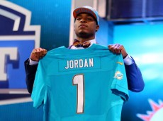 NEW YORK, NY - APRIL 25:  Dion Jordan of the Oregon Ducks holds up a jersey on stage after he was picked #3 overall by the Miami Dolphins in the first round of the 2013 NFL Draft at Radio City Music Hall on April 25, 2013 in New York City.  (Photo by Al Bello/Getty Images)