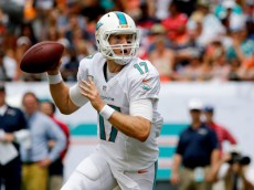 MIAMI GARDENS, FL - SEPTEMBER 07: Ryan Tannehill #17 of the Miami Dolphins scrambles in the pocket during the first quarter of the game against the New England Patriots at Sun Life Stadium on September 7, 2014 in Miami Gardens, Florida.  (Photo by Rob Foldy/Getty Images)