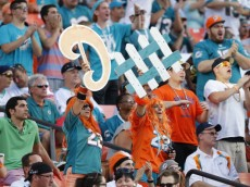 MIAMI GARDENS, FL - NOVEMBER 17: Miami Dolphins fans hold a 'defense' sign up while the San Diego Chargers have the ball during second quarter action on November 17, 2013 at Sun Life Stadium in Miami Gardens, Florida. The Dolphins defeated the Chargers 20-16. (Photo by Joel Auerbach/Getty Images)