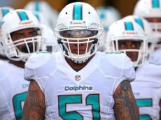 JACKSONVILLE, FL - AUGUST 09:  Mike Pouncey #51 of the Miami Dolphins leads the team onto the field during a preseason game against the Jacksonville Jaguars at EverBank Field on August 9, 2013 in Jacksonville, Florida.  (Photo by Mike Ehrmann/Getty Images)