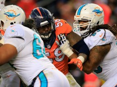 DENVER, CO - NOVEMBER 23:  Outside linebacker Von Miller #58 of the Denver Broncos battles the block of guard Dallas Thomas #63 of the Miami Dolphins at Sports Authority Field at Mile High on November 23, 2014 in Denver, Colorado. The Broncos defeated the Dolphins 39-36.  (Photo by Doug Pensinger/Getty Images)