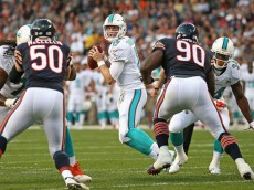 CHICAGO, IL - AUGUST 13:  Ryan Tannehill #17 of the Miami Dolphins looks for a receiver as Shea McClellin #50 and Jeremiah Ratliff #90 of the Chicago Bears rush during a preseason game at Soldier Field on August 13, 2015 in Chicago, Illinois.  (Photo by Jonathan Daniel/Getty Images)