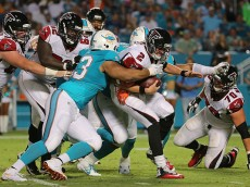 MIAMI GARDENS, FL - AUGUST 29:  Matt Ryan #2 of the Atlanta Falcons is sacked by Cameron Wake #91 and Ndamukong Suh #93 of the Miami Dolphins during a preseason game  at Sun Life Stadium on August 29, 2015 in Miami Gardens, Florida.  (Photo by Mike Ehrmann/Getty Images)
