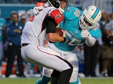 MIAMI GARDENS, FL - AUGUST 29:  Matt Ryan #2 of the Atlanta Falcons is sacked by Olivier Vernon #50 of the Miami Dolphins during a preseason game  at Sun Life Stadium on August 29, 2015 in Miami Gardens, Florida.  (Photo by Mike Ehrmann/Getty Images)