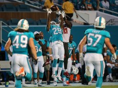 MIAMI GARDENS, FL - SEPTEMBER 03: Will Davis #29 of the Miami Dolphins catches an interception over Sterling Moore #26 of the Tampa Bay Buccaneers during a preseason game  at Sun Life Stadium on September 3, 2015 in Miami Gardens, Florida.  (Photo by Mike Ehrmann/Getty Images)