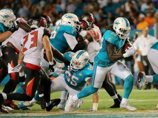 MIAMI GARDENS, FL - SEPTEMBER 03:  Jay Ajayi #33 of the Miami Dolphins rushes during a preseason game against the Tampa Bay Buccaneers at Sun Life Stadium on September 3, 2015 in Miami Gardens, Florida.  (Photo by Mike Ehrmann/Getty Images)