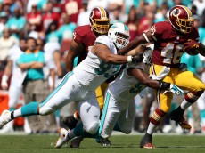 LANDOVER, MD - SEPTEMBER 13: Running back Alfred Morris #46 of the Washington Redskins breaks past defensive tackle Ndamukong Suh #93 of the Miami Dolphins and outside linebacker Jelani Jenkins #53 of the Miami Dolphins in the first half of a game at FedExField on September 13, 2015 in Landover, Maryland. (Photo by Patrick Smith/Getty Images)