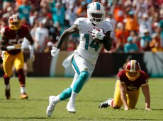 LANDOVER, MD - SEPTEMBER 13: Wide receiver Jarvis Landry #14 of the Miami Dolphins carries the ball for a second half touchdown during a game against the Washington Redskins at FedExField on September 13, 2015 in Landover, Maryland. (Photo by Rob Carr/Getty Images)