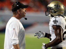 MIAMI GARDENS, FL - AUGUST 29: Head Coach Sean Payton (L) of the New Orleans Saints chats with defender Corey White #24  against the Miami Dolphins at Sun Life Stadium on August 29, 2013 in Miami Gardens, Florida.  (Photo by Marc Serota/Getty Images)