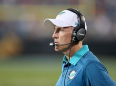 CHARLOTTE, NC - AUGUST 22:  Head coach Joe Philbin of the Miami Dolphins watches on against the Carolina Panthers during their game at Bank of America Stadium on August 22, 2015 in Charlotte, North Carolina.  (Photo by Streeter Lecka/Getty Images)