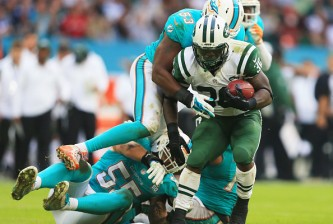 LONDON, ENGLAND - OCTOBER 04:   Darrin Walls #30 of the New York Jets is tackled by  Jelani Jenkins #53 of the Miami Dolphins during the game at Wembley Stadium on October 4, 2015 in London, England.  (Photo by Stephen Pond/Getty Images)