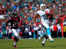 MIAMI GARDENS, FL - OCTOBER 25:  Rishard Matthews #18 of the Miami Dolphins runs the ball back for a touchdown in the first quarter as  Andre Hal #29 of the Houston Texans looks on during a game at Sun Life Stadium on October 25, 2015 in Miami Gardens, Florida.  (Photo by Chris Trotman/Getty Images)