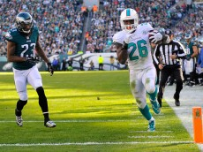 PHILADELPHIA, PA - NOVEMBER 15:  Lamar Miller #26 of the Miami Dolphins scores a second quarter touchdown reception against Malcolm Jenkins #27 and Nolan Carroll #23 of the Philadelphia Eagles at Lincoln Financial Field on November 15, 2015 in Philadelphia, Pennsylvania.  (Photo by Alex Goodlett/Getty Images)