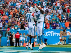 MIAMI GARDENS, FL - DECEMBER 06:  DeVante Parker #11 of the Miami Dolphins celebrates his touchdown in the second quarter with teammate Dion Sims #80 of the Miami Dolphins Dion Sims #80 of the Miami Dolphins at Sun Life Stadium on December 6, 2015 in Miami Gardens, Florida.  (Photo by Chris Trotman/Getty Images)