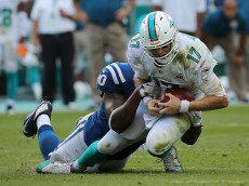 MIAMI GARDENS, FL - DECEMBER 27:  Ryan Tannehill #17 of the Miami Dolphins is sacked by Kendall Langford #90 of the Indianapolis Colts during a game  at Sun Life Stadium on December 27, 2015 in Miami Gardens, Florida.  (Photo by Mike Ehrmann/Getty Images)