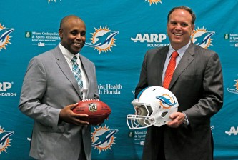 Miami Dolphins new general manager Chris Grier poses with Mike Tannenbaum, executive vice president of Football Operations, after a press conference at the Miami Dolphins' training facility in Davie, Fla., on Monday, Jan. 4, 2016. (Charles Trainor Jr./Miami Herald/TNS via Getty Images)