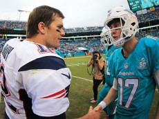 MIAMI GARDENS, FL - JANUARY 03: Tom Brady #12 of the New England Patriots and Ryan Tannehill #17 of the Miami Dolphins shake hands after the game at Sun Life Stadium on January 3, 2016 in Miami Gardens, Florida. (Photo by Mike Ehrmann/Getty Images)