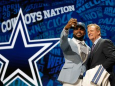 CHICAGO, IL - APRIL 28:  (L-R) Ezekiel Elliott of Ohio State poses with NFL Commissioner Roger Goodell after being picked #4 overall by the Dallas Cowboys during the first round of the 2016 NFL Draft at the Auditorium Theatre of Roosevelt University on April 28, 2016 in Chicago, Illinois.  (Photo by Jon Durr/Getty Images)
