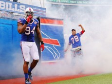 ORCHARD PARK, NY - NOVEMBER 30:   Mario Williams #94 of the Buffalo Bills leads his team onto the field before the game against the Cleveland Browns at Ralph Wilson Stadium on November 30, 2014 in Orchard Park, New York.  (Photo by Brett Carlsen/Getty Images)