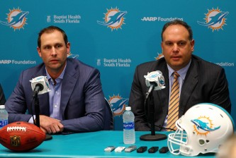 DAVIE, FL - APRIL 29:  Head coach Adam Gase and Executive Vice President, Football Operations	Mike Tannenbaum of the Miami Dolphins talks to members of the press concerning first round draft pick Laremy Tunsil at their training faciility on April 29, 2016 in Davie, Florida.  (Photo by Mike Ehrmann/Getty Images)