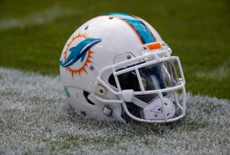 LANDOVER, MD - SEPTEMBER 13: A Miami Dolphins helmet sits on the grass before the start of their game against the Washington Redskins at FedExField on September 13, 2015 in Landover, Maryland.  (Photo by Rob Carr/Getty Images)