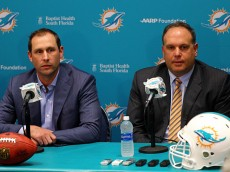 of the Miami Dolphins talks to members of the press concerning first round draft pick Laremy Tunsil at their training faciility on April 29, 2016 in Davie, Florida.