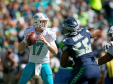 SEATTLE, WA - SEPTEMBER 11: Quarterback Ryan Tannehill #17 of the Miami Dolphins looks for a target against the Seattle Seahawks in the first half at CenturyLink Field on September 11, 2016 in Seattle, Washington. (Photo by Otto Greule Jr/Getty Images)