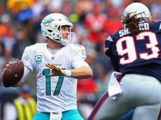 FOXBORO, MA - SEPTEMBER 18:  Ryan Tannehill #17 of the Miami Dolphins looks to pass the ball during the first half against the New England Patriots at Gillette Stadium on September 18, 2016 in Foxboro, Massachusetts.  (Photo by Maddie Meyer/Getty Images)