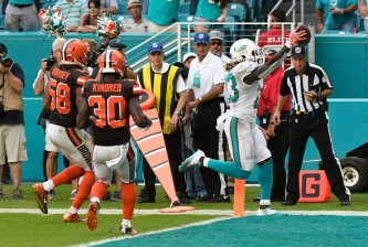 MIAMI GARDENS, FL - SEPTEMBER 25: Jay Ajayi #23 of the Miami Dolphins scores a touchdown in overtime to defeat the Cleveland Browns on September 25, 2016 in Miami Gardens, Florida. (Photo by Eric Espada/Getty Images)