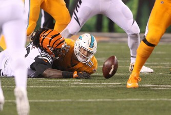 CINCINNATI, OH - SEPTEMBER 29:  Will Clarke #93 of the Cincinnati Bengals tackles Ryan Tannehill #17 of the Miami Dolphins and causes a fumble during the second quarter at Paul Brown Stadium on September 29, 2016 in Cincinnati, Ohio. (Photo by John Grieshop/Getty Images)