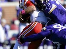 Minnesota defensive tackle Sharrif Floyd, top, and Minnesota defensive end Danielle Hunter combine to sack Kansas City quarterback Alex Smith in the second quarter at TCF Bank Stadium on Sunday, October 18, 2015. The Vikings beat Kansas City, 16-10. (Pioneer Press: John Autey)