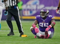 Oct 13, 2013; Minneapolis, MN, USA; Minnesota Vikings defensive tackle Sharrif Floyd (95) sits after getting a penalty for grabbing the the facemask of the Carolina Panthers quarterback negating the sack in the second quarter at Mall of America Field at H.H.H. Metrodome. The sack was negated by the penalty. Panthers win 35-10. Mandatory Credit: Bruce Kluckhohn-USA TODAY Sports
