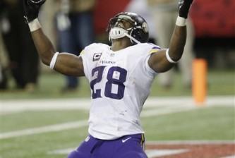Minnesota Vikings running back Adrian Peterson (28) celebrates his touchdown against the Atlanta Falcons during the second half of an NFL football game, Sunday, Nov. 29, 2015, in Atlanta. The Minnesota Vikings won 201-10. (AP Photo/David Goldman)