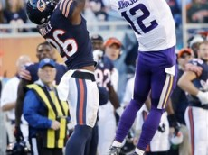 Minnesota Vikings receiver Charles Johnson (12) makes a catch against under pressure from Chicago Bears safety Antrel Rolle (26) the second half of an NFL football game, Sunday, Nov. 1, 2015, in Chicago. The Vikings won 23-20. (AP Photo/Charles Rex Arbogast)